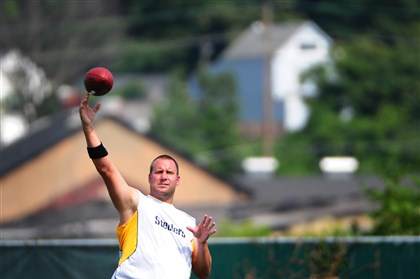 20140818jrBenSteelers1 Ben Roethlisberger warms up at practice for the Steelers Monday on the South Side.