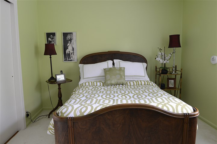 Buying Here: Scott The master bedroom is painted a spring green and has an extra-large, extra-deep closet.