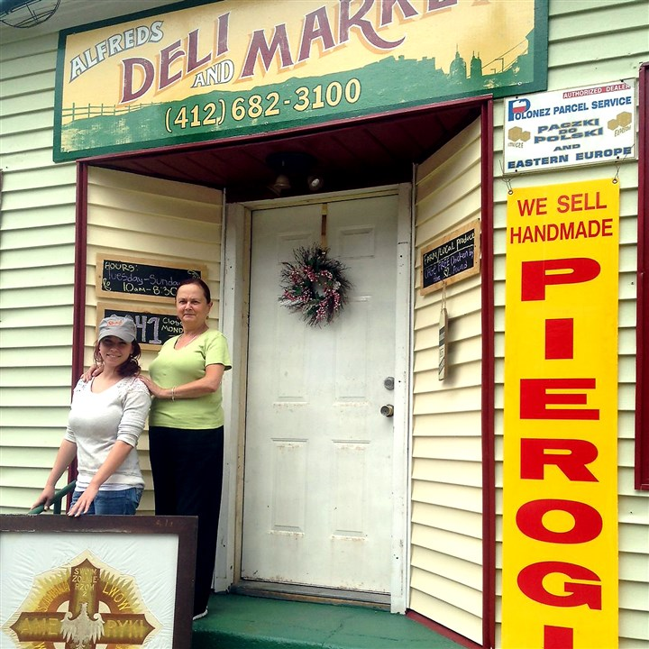 20140818hoportfolio0819age2 Anna Misiaszek stands with her daughter Natalie Misiaszek outside their new Alfred's Deli & Market in Polish Hill.