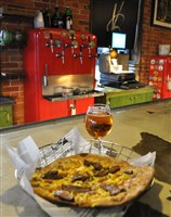 The Breakfast Pizza at Voodoo Brewery in Meadville, topped with sausage gravy, eggs, a cheddar cheese blend and steak from Pasture Perfect Beef, with snifter of Voodoo Good Vibes IPA.