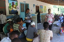 At Albert Schweitzer Hopital in Haiti, Marie Roline Castor Roline prepares to lead a morning education session with patients as they wait to be seen at the Deschapelles dispensary.