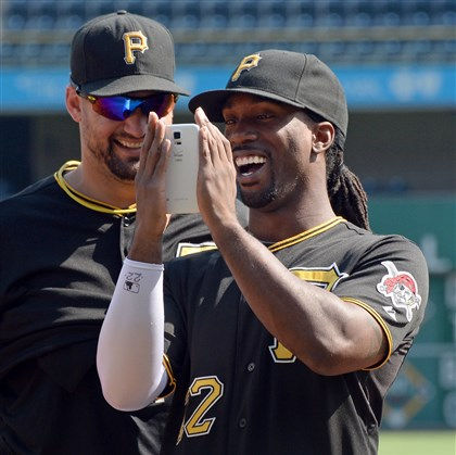 20140819mfbucssports04-3 Pirates center fielder Andrew McCutchen shows his ALS Ice Bucket Challenge video to teammate Gaby Sanchez before batting practice at PNC Park this afternoon. McCutchen returned from the disabled list for his team's game against the Braves.