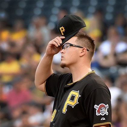 20140818pdPiratesSports06 Pittsburgh Pirates starter Vance Worley reacts after giving up run number 6 to the Braves in the first inning at PNC Park.