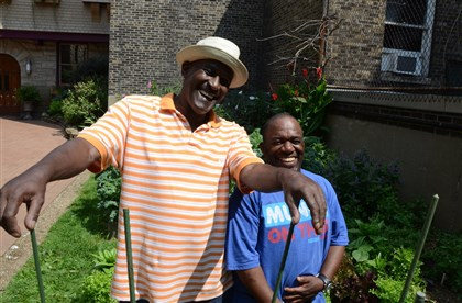 20140819dohomesymca2-1 Rodney Tucker (left) and Michael Rushin take a break in the Allegheny YMCA on the North Side in The Boxy Caufield Memorial Garden on the grounds of the YMCA.