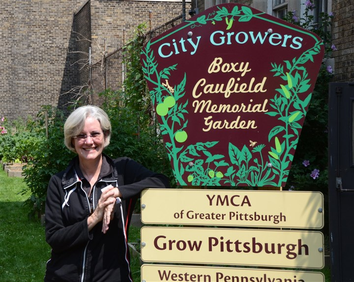 20140819dohomesymca9-7  Mary Collins, office manager of the Allegheny YMCA on the North Side, in The Boxy Caufield Memorial Garden on the grounds of the YMCA.