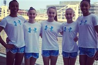 The Parkettes, from left, Margzetta Frazier, Megan Freed, Christina Desiderio, Molly Frack and Taylor Lawson are representing Pennsylvania in the P&G National Gymnastics Championships this week at Consol Energy Center.