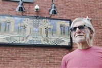 "Lawyer-turned-artist Glenn Olcerst is self-taught in creating glass and stone pieces. He designed and made this mosaic, named ""First Historic District."" It is now mounted on a wall on the outside of his home on the North Side."