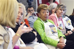 Cecile Springer, center, a community activist, listens to a discussion about HPV vaccination during a news conference Wednesday announcing the formation of a Pittsburgh chapter of Grandmother Power.