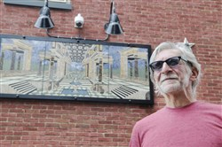 "Lawyer-turned-artist Glenn Olcerst is self-taught in creating glass and stone pieces. He designed and made this mosaic, named ""First Historic District."" It is now mounted on his home."