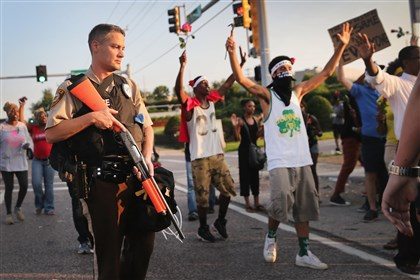 stLouis83 Demonstrators protest the killing of teenager Michael Brown on in Ferguson, Missouri.
