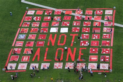 "National Sexual Violence Conference quilt 3 Several quilts contain messages from survivors of sexual assault along with the statement ""Not Alone."" The Monument Quilt was display at Point State Park for Wednesday as part of the National Sexual Violence Conference happening this week in Downtown Pittsburgh."