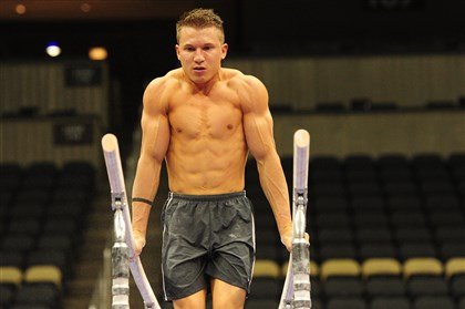 20140820jrSportsGym14 Jonathan Horton trains on the parallel bars Wednesday at Consol Energy Center.