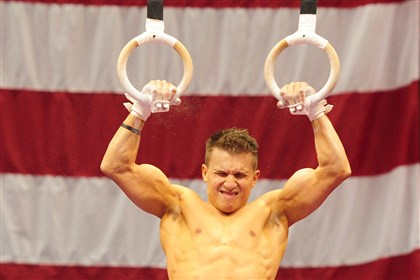 20140820jrSportsGym18-1 Jonathan Horton trains on the still rings Wednesday at Consol Energy Center.