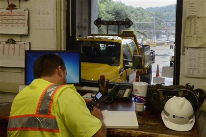 20140820rldFortPittTunnel03-2 Tunnel maintenance supervisor Todd Caddy, of Carnegie, monitors the closure of HOV lanes from inside the Fort Pitt Tunnel.