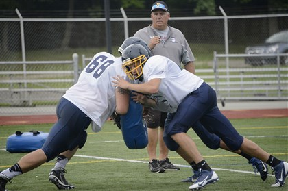 20140811radMarsFootballSpts.12.jpg Mars Area coach Scott Heinauer oversees a blocking drill at Mars Area High School during practice. The Planets are looking to make a seventh consecutive postseason appearance.