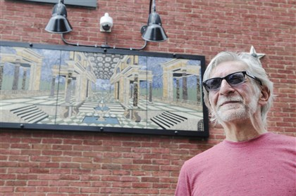 "20140820DARGlennOlcerstArtMag06-6  Lawyer-turned-artist Glenn Olcerst is self-taught in creating glass and stone pieces. He designed and made this mosaic, named ""First Historic District."" It is now mounted on his home."