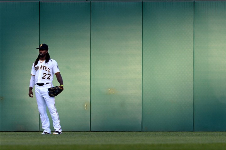 20140819mfbucssports08 Pirates' Andrew McCutchen stands in center field in the first inning against the Braves at PNC Park Tuesday night after returning from the disabled list.
