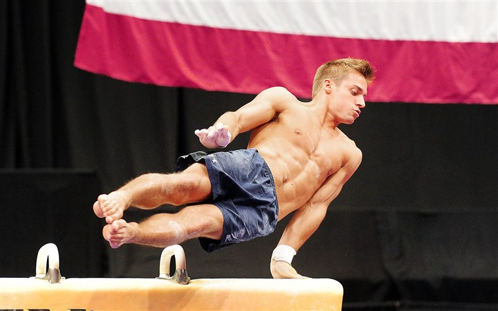20140820jrSportsGym15-1 Sam Mikulak trains on the pommel horse Wednesday at Consol Energy Center.