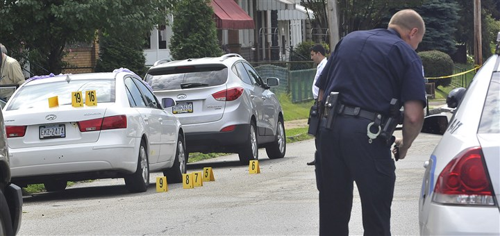 20140820lrnewKkillinglocal06 Police mark where bullet casings were found Wednesday after the fatal shooting in the 400 block of Fourth Avenue in New Kensington.