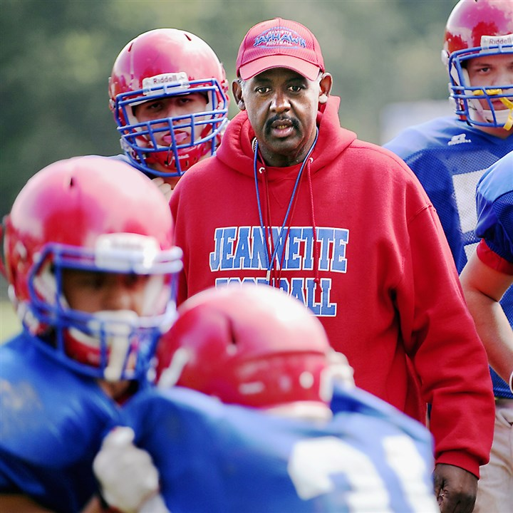 "20140813CMJeannetteFootball.jpg Jeannette football coach Roy Hall on his team's approach this season: ""We're going to stick with our wing-T offense. We've been running that for the last 10 years."""