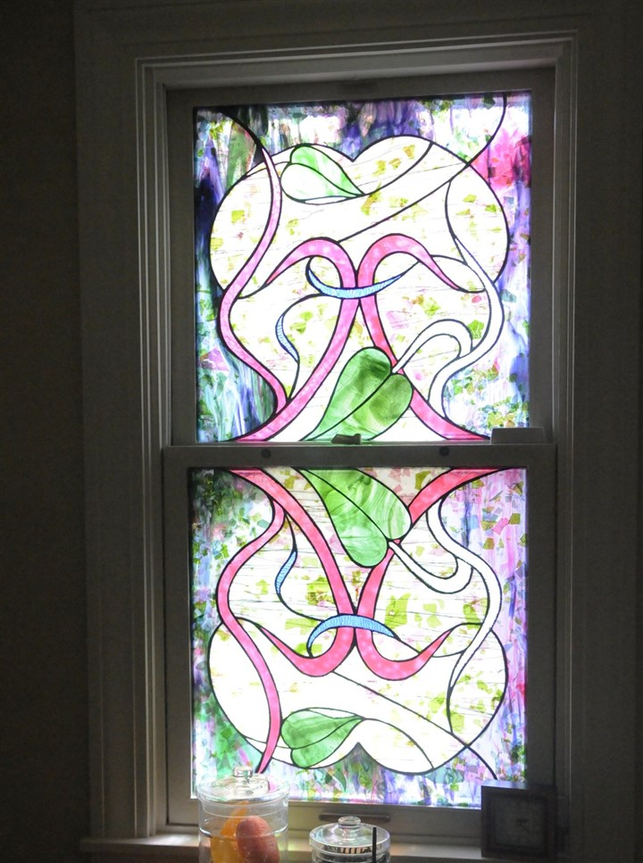 20140820DARGlennOlcerstArtMag03-2 Lawyer-turned-artist Glenn Olcerst created this stained glass window that sits in an upstairs bathroom in his house on the North Side.