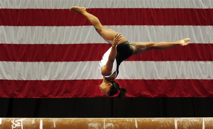 20140820jrGymSports7-5 Simone Biles trains on the balance beam ahead of the 2014 P&G Gymnastic Championships Wednesday at Consol Energy Center.