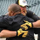 Brett Keisel gives a big hug to former Steeler Duce Staley, now a coach with the Eagles, before Thursday night's preseason game at Lincoln Financial Field in Philadelphia.
