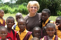 In this Oct. 7, 2013, file photo, provided by Jeremy Writebol, his mother, Nancy Writebol, poses with children in Liberia. Nancy Writebol is one of two Americans working for a missionary group in Liberia who were infected with the Ebola virus.
