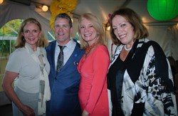 Tom Slivka, Founder of Looks for Love and representatives of Ladies Hospital Aid Society, June Yonas, Laura Penrod Kronk and Carole Kamin.