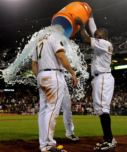 20140820mfbucssports11-3 Pirates' Gaby Sanchez gets a bucket of ice water dumped on his head by Andrew McCutchen and Josh Harrison after hitting a walk-off sacrifice fly against the Braves in the ninth inning at PNC Park Wednesday night, August 20, 2014.