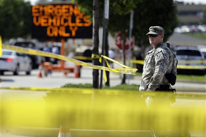National Guard Missouri 0821 A member of the Missouri National Guard stands guard at a police command post Tuesday in Ferguson, Mo. Jeff Roberson