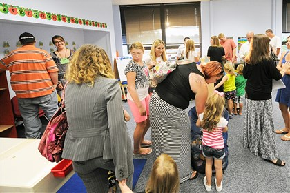 20140819JHWestPreK04-3 New students and their families check out one of two newly remodeled Pre-K classrooms at the open house at J.W. Burkett Elementary School in Robinson.