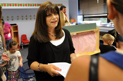 20140819JHWestPreK03-2 Pre-K teacher Lynne Jones, center, chats with parents at an open house in one of two newly remodeled Pre-K classroom at J.W. Burkett Elementary School in Robinson.