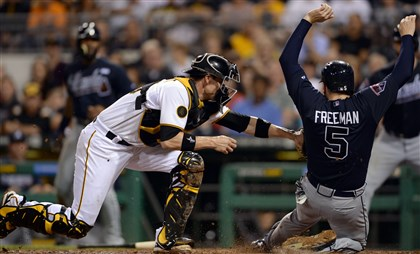 20140820mfbucssports06-5 Pirates catcher Chris Stewart tags out Braves' Freddie Freeman in the sixth inning at PNC Park Wednesday night.