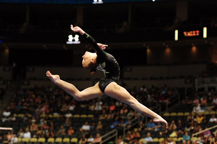 20140821jrSportsGym4-3 Emily Gaskins does her floor routine Thursday during the Junior Women's portion of the 2014 P&G Gymnastic Championships at Consol Energy Center.