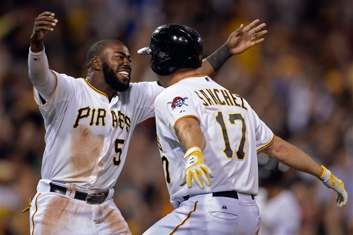 20140820mfbucssports10-2 Josh Harrison congratulates Gaby Sanchez for hitting a walk-off sacrifice fly in the ninth inning to beat the Braves at PNC Park Wednesday night.