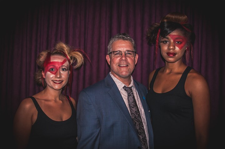 lookslove Tom Slivka, a hair stylist at Capristo Salon and Wellness Spa, and Founder of Looks for Love with two models, Thea Souply (on Tom's left) and Sydney Penn (on the right), featuring hair styles Tom designed for the event.