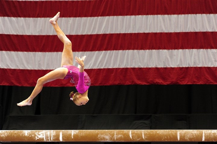 20140821jrSportsGym1 Olivia Trautman competes on the balance beam during the Junior Women's portion of the 2014 P&G Gymnastic Championships Thursday at Consol Energy Center.