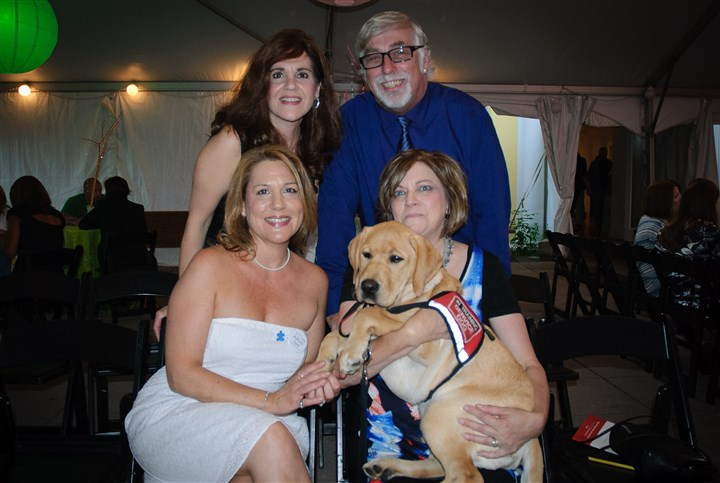 lookslove2-1 Starting in the back, left to right, Lisa Martinelli, Jim Wagner of Perfect Fit Canines; in the front Anita Martinelli-Land, a stylist at Capristo Salon and Wellness Spa and mother of 11-year old Jake, future recipient of a service dog; and Susan Wagner of Perfect Fit Canines. Susan is holding Landon, a service dog in training.