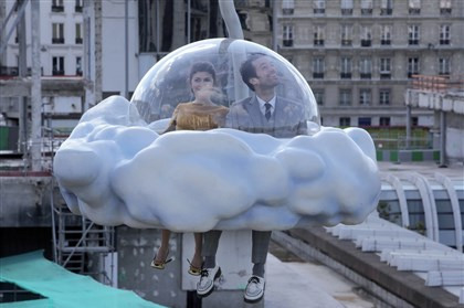 """Mood Indigo.""  Tres charmant: Chloe (Audrey Tautou) and Colin (Romain Duris) tour the city from above in ""Mood Indigo."""