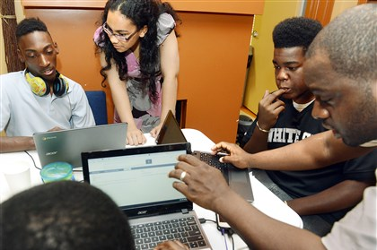 Oasis Project in Homewood From left, Montana Howard, 16, of Homewood; Debralyn Woodberry-Shaw, program manager; Evan Nevels,15, of the Hill District; and mentor Jomari Peterson work on building websites for their homemade products.