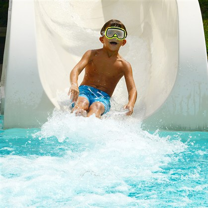 Crafton pool Tony Burkhart, 7, of Crafton, goes down the water slide at the Crafton pool on Friday.