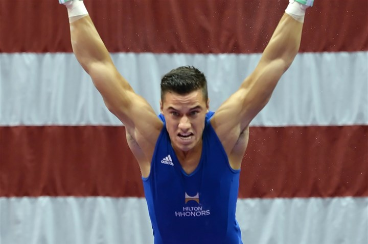 20140822mfgymsports13.jpg Matt Freed/Post-Gazette August 22, 2014 Jacob Dalton performs on the rings during the Senior Men's portion of the P&G Gymnastics Championships at Consol Energy Center Friday night.