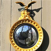 A fine American classical carved and gilded convex mirror, circa 1815-20, from Thomas Schwenke.
