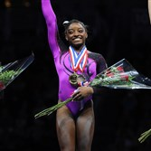 Simone Biles, center, takes first place at the senior women portion of the P&G Gymnastics Championships at Consol Energy Center Saturday night. On her left is Kayla Ross, second place, and on her right, is Maggie Nichols, third place.