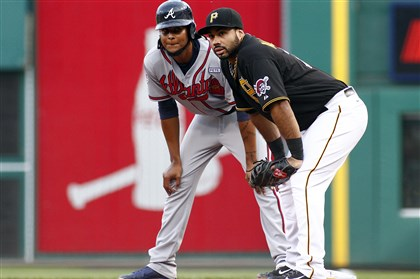Pedro Alvarez holds Atlanta's Ervin Santana on at first Pedro Alvarez holds Atlanta's Ervin Santana on at first in his major league debut at the position Monday at PNC Park.