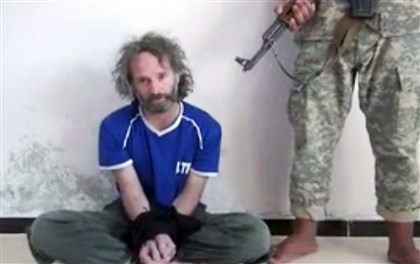 AmericanFreedSyria2-1 In this image made from undated video that The Associated Press obtained, a man believed to be Peter Theo Curtis delivers a statement.