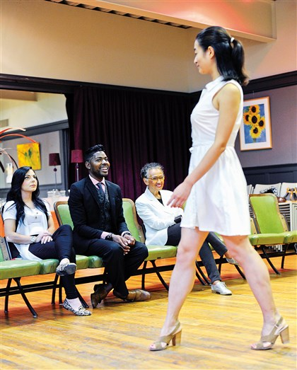 20140824CMRunwayMag004-3 Jaylee Lemon, center, watches Nicole Xu of Shadyside practice her runway walk.
