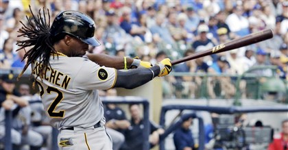 Pirates Brewers Baseball Pirates' Andrew McCutchen hits a home run during the ninth inning of this afternoon's game against the Milwaukee Brewers in Milwaukee. The Pirates lost, 4-3.