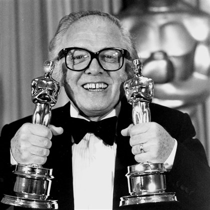 "9s700n3q British actor and director Richard Attenborough holds his two Oscars for his epic movie ""Gandhi"" at the 55th annual Academy Awards in Los Angeles in 1983."